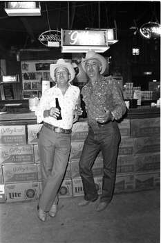Ronald Labiolais and Steve Broussard at Gilley's Club in Pasadena, Texas. Photo: Ben DeSoto, Houston Chronicle