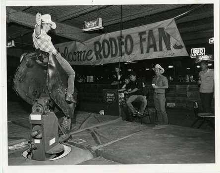 Lance Turner rides the mechanical bull at Gilley's Club on May 24, 1985. Photo: Ben DeSoto, Houston Chronicle