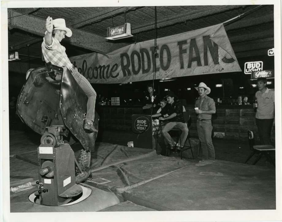05/24/1985 - Lance Turner rides the mechanical bull at Gilley's Club. Photo: Ben DeSoto, Houston Chronicle