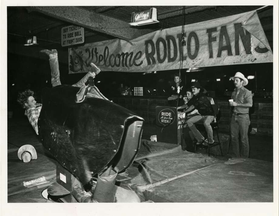 05/24/1985 - Lance Turner falls off the mechanical bull at Gilley's Club. Photo: Ben DeSoto, Houston Chronicle