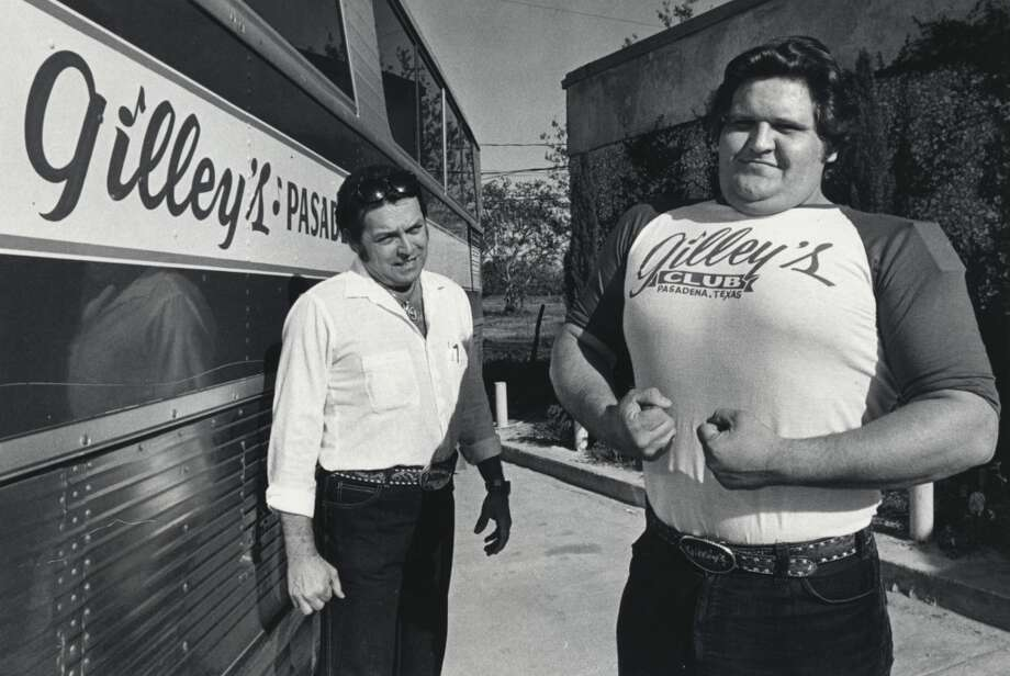 "04/16/1980 - Mickey Gilley, left, with ""Killer""  David Ogle, Gilley's Club bouncer who was featured in the movie ""Urban Cowboy"".      HOUCHRON CAPTION (05/15/2005) SECNEWS:  ON SCREEN:  Gilley, left, and Gilley's bouncer, ""Killer"" David Ogle, both made appearances in ""Urban Cowboy,"" the movie that made the club famous. Photo: King Chou Wong, Houston Chronicle"