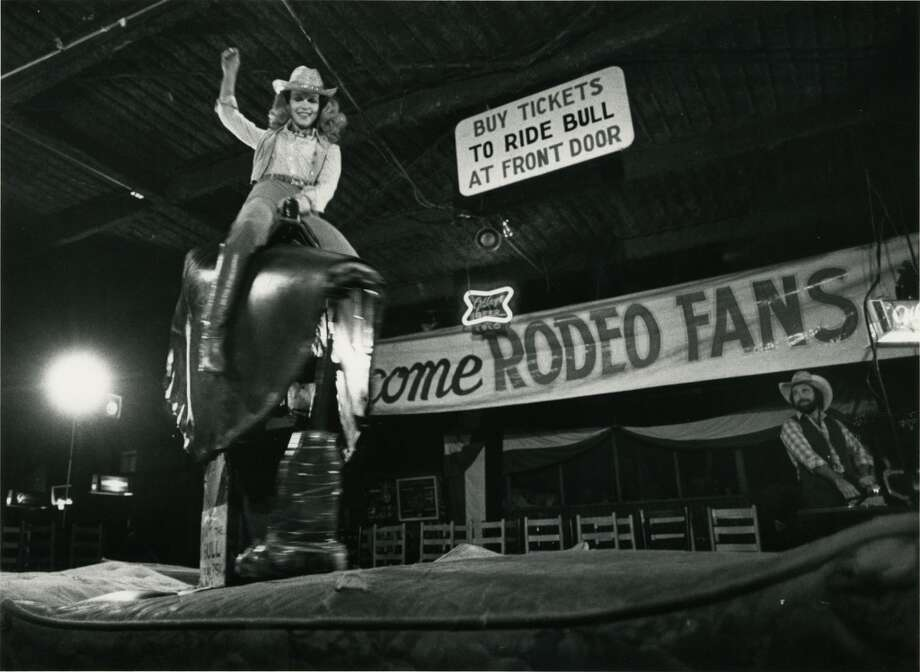 PHOTOS: Remembering Gilley's in PasadenaLynn Wyatt, one of the chairmen of the benefit premiere of Urban Cowboy,  rides the mechanical bull at Gilley's Club. Photo: Fred Bunch, Houston Chronicle