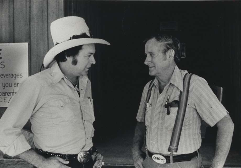 Mickey Gilley, left,  and Sherwood Cryer, owner of Gilley's Club, shot in June 20, 1980 in Pasadena.    HOUCHRON CAPTION (05/15/2005) SECNEWS:  ORIGINALS:  Mickey Gilley, left, handled the singing and Sherwood Cryer ran Gilley's when this photo was taken at the Pasadena club in 1980. Photo: Joel Draut, Houston Chronicle