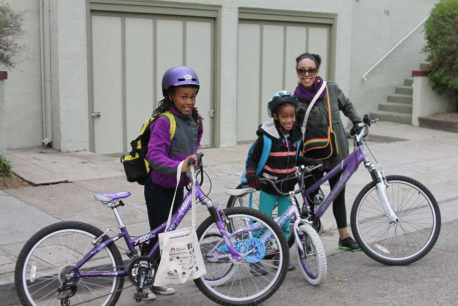 Tsadae Neway rode with her daughters Yahsimavet, 10, and Taqami, 8, on Bike to School Day. Photo: Bike East Bay