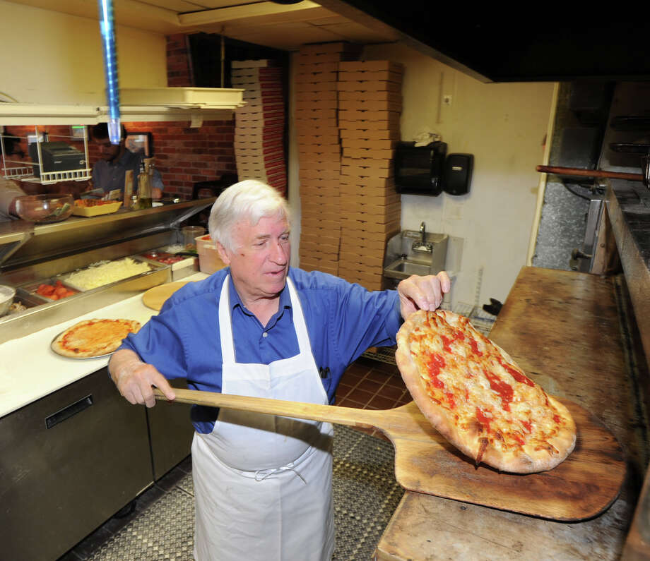 Luca Criscuolo, founder of the Pizza Post, makes his famous Margherita Pizza at the restaurant located in the Cos Cob section of Greenwich, Conn., Thursday, May 22, 2014. Photo: Bob Luckey / Greenwich Time
