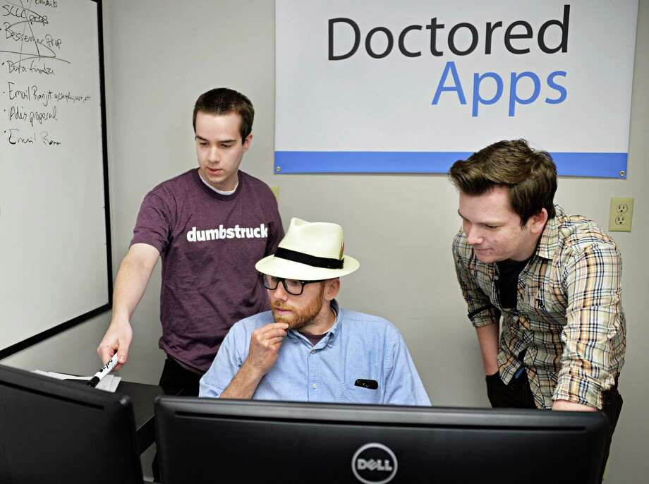 Doctored Apps CTO Mike Tanski, left, CEO Peter Allegretti and head of product design Keith Ressell, right, in the Doctored Apps office Wednesday May 21, 2014, in Colonie, NY.  (John Carl D'Annibale / Times Union) Photo: John Carl D'Annibale / 00026983A