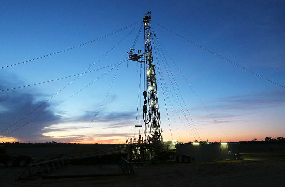 The sun sets on a drilling rig in Frio County. Loan standards have become stricter in the Eagle Ford and other shale plays as lenders shouldn't have too much invested in projects dependent on the shale boom. Photo: Express-News File Photo / © 2013 San Antonio Express-News