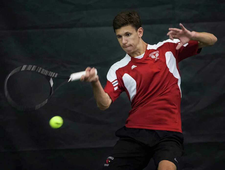Greenwich high school's Chris Salisbury during an FCIAC quarterfinal boys tennis match against Fairfield Warde high school's Eyad Nagori played at Sound Shore Indoor Tennis, Port Chester, NY on Thursday, May, 22nd, 2014. Photo: Mark Conrad / Connecticut Post Freelance