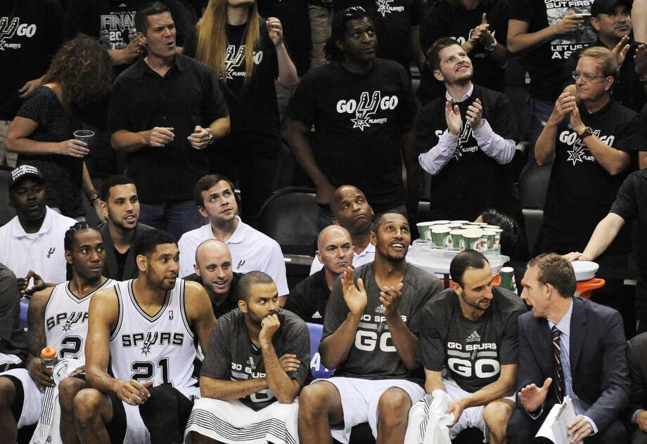 San Antonio Spurs players and fans celebrate in the closing minutes of Game 1 of a Western Conference finals NBA basketball playoff series against the Oklahoma City Thunder, Monday, May 19, 2014, in San Antonio. San Antonio won 122-105. Photo: Darren Abate, Associated Press