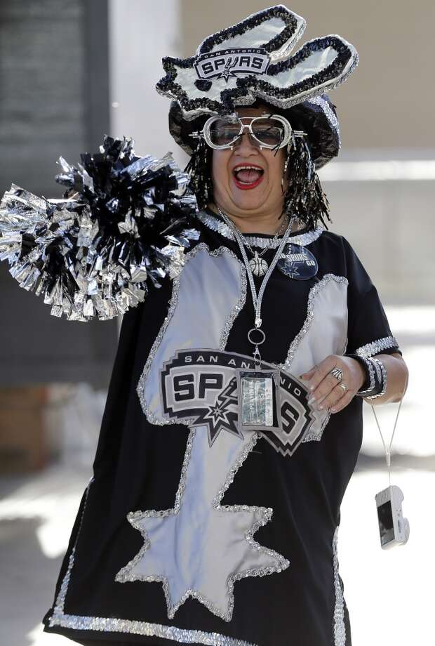 San Antonio Spurs fan Sovia Lauriano cheers outside the AT&T Center prior to Game 1 of a Western Conference finals NBA basketball playoff series between the San Antonio and the Oklahoma City Thunder, Monday, May 19, 2014, in San Antonio. Photo: Eric Gay, Associated Press