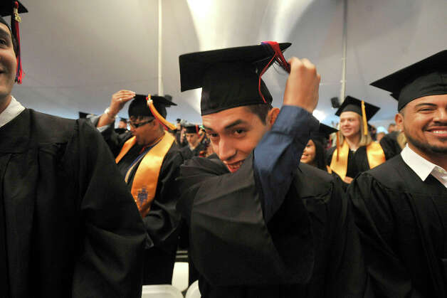 Lee Sanchez, of Greenwich, moves his tassle from one side to the other during the Norwalk Community College commencement ceremony at the community college in Norwalk, Conn., on Thursday, May 22, 2014. Photo: Jason Rearick / Stamford Advocate
