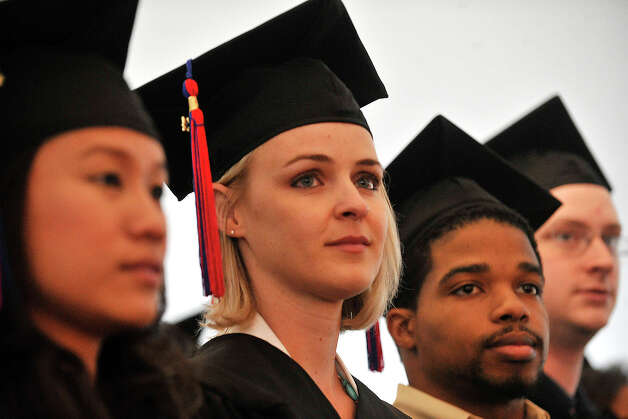 From left: Weerawan Kamonvatthana, of Norwalk, Keli Gehrke, of Bridgeport, Joshua Buffaloe, of Stamford, and Justin Alexander Singleton, of Weston, look on during the Norwalk Community College commencement ceremony at the community college in Norwalk, Conn., on Thursday, May 22, 2014. Photo: Jason Rearick / Stamford Advocate