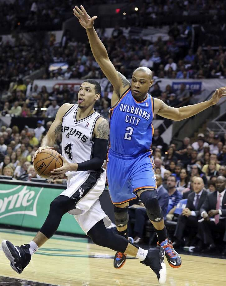 San Antonio Spurs' Danny Green drives around Oklahoma City Thunder's Caron Butler during second half action of Game 2 in the Western Conference Finals Wednesday May 21, 2014 at the AT&T Center. The Spurs won 112-77. Photo: Edward A. Ornelas, San Antonio Express-News