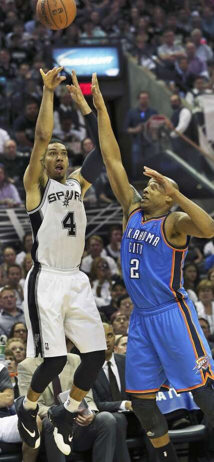 Danny Green lets loose for another three pointer against Caron Butler as the San Antonio Spurs play the Oklahoma City Thunder in game 2 of the Western Conference Finals at the AT&T Center on May 21, 2014. Photo: Tom Reel, San Antonio Express-News