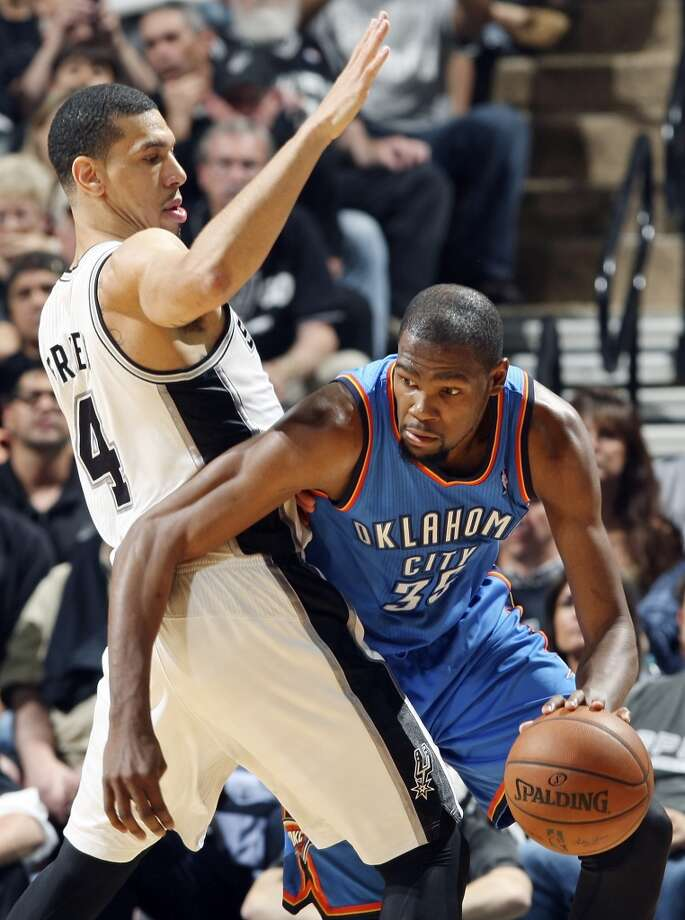 San Antonio Spurs' Danny Green defends Oklahoma City Thunder's Kevin Durant during second half action of Game 1 in the Western Conference Finals Monday May 19, 2014 at the AT&T Center. The Spurs won 122-105. Photo: Edward A. Ornelas, San Antonio Express-News