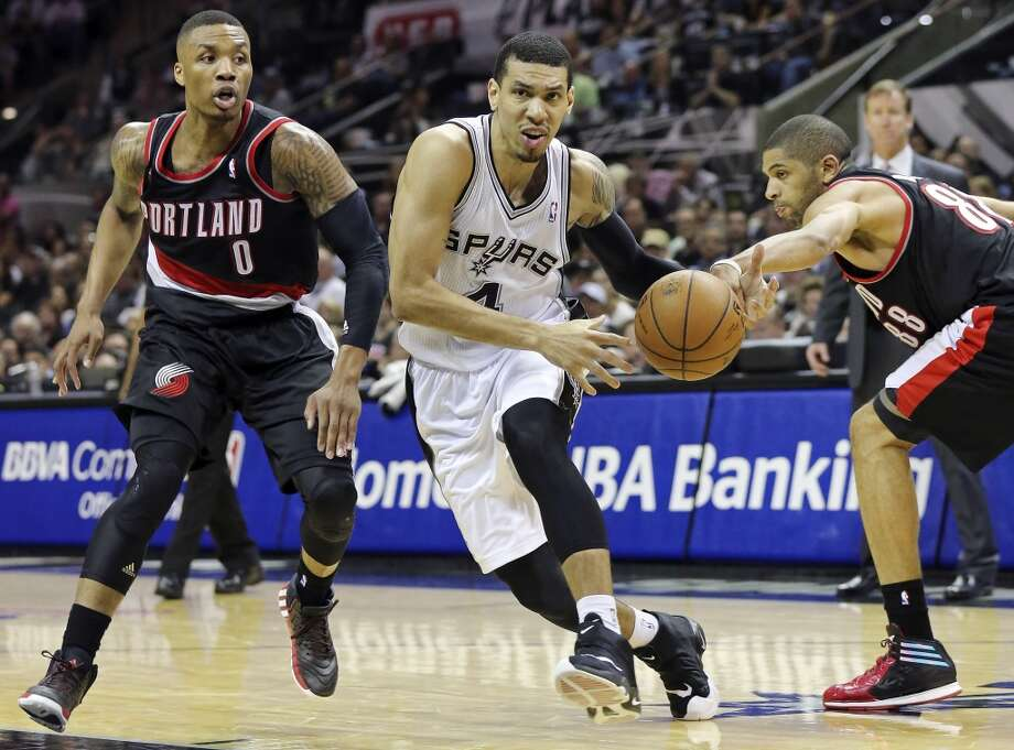 San Antonio Spurs' Danny Green drives between Portland Trail Blazers' Damian Lillard (left) and Nicolas Batum during second half action of Game 1 in the Western Conference semifinals Tuesday May 6, 2014 at the AT&T Center. The Spurs won 116-92. Photo: Edward A. Ornelas, San Antonio Express-News