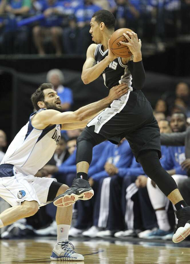 Dallas Mavericks' Jose Calderon hand checks San Antonio Spurs' Danny Green during the first half of game six in the first round of the Western Conference Playoffs at the American Airlines Center in Dallas, Friday, May 2, 2014. Photo: Jerry Lara, San Antonio Express-News