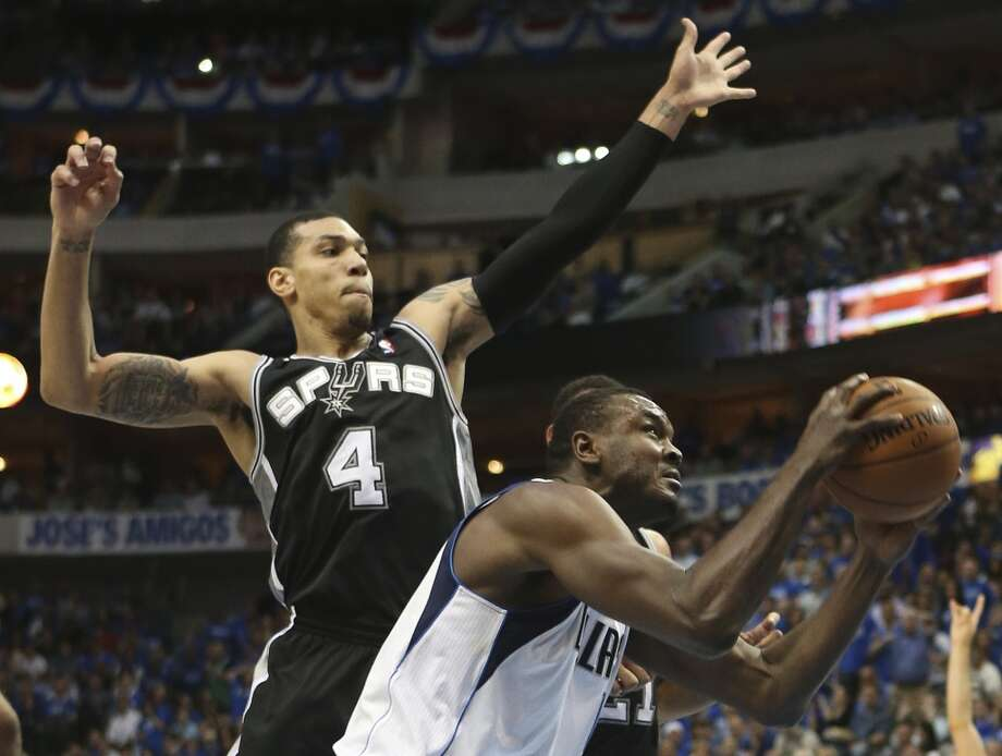 San Antonio Spurs' Danny Green reaches in to block a shot by Dallas Mavericks' Samuel Dalembert during the first half of game six in the first round of the Western Conference Playoffs at the American Airlines Center in Dallas, Friday, May 2, 2014. Photo: Jerry Lara, San Antonio Express-News