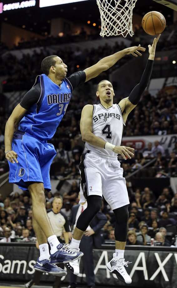 San Antonio Spurs' Danny Green shoots around Dallas Mavericks' Brandan Wright during second half action of Game 1 in the first  round of the Western Conference playoffs Sunday April 20, 2014 at the AT&T Center. The Spurs won 90-85. Photo: Edward A. Ornelas, San Antonio Express-News