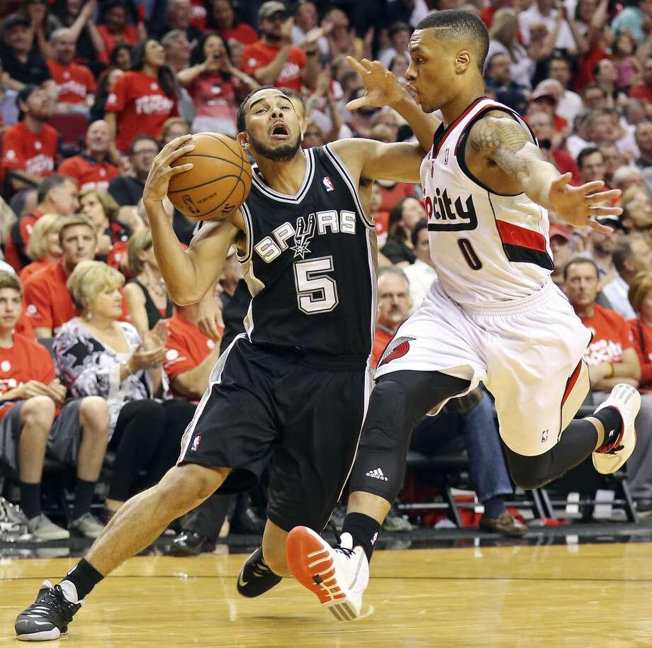 San Antonio Spurs' Cory Joseph if fouled by Portland Trail Blazers' Damian Lillard during second half action of Game 4 in the Western Conference semifinals Monday May 12, 2014 at the Moda Center in Portland, OR. The Portland Trail Blazers won 103-92. Photo: Edward A. Ornelas, San Antonio Express-News