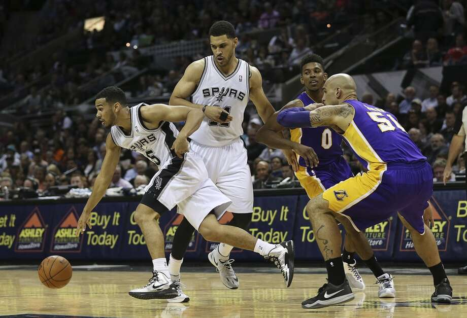 San Antonio Spurs' Cory Joseph drives the ball during the second half against the Los Angeles Lakers at the AT&T Center, Wednesday, April 16, 2014. The Lakers won 113-100. Photo: Jerry Lara, San Antonio Express-News