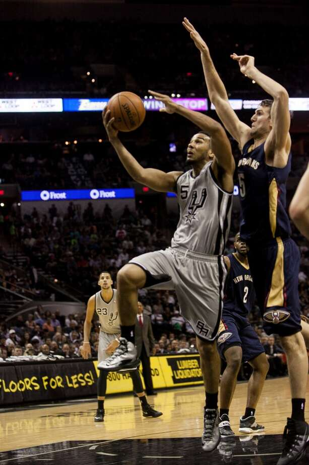 Cory Joseph takes a shot against the New Orleans Pelicans in the second half, Saturday March 29, 2014 at the AT&T Center. The Spurs kept a steady lead throughout the entire game and won 96-80. Photo: Julysa Sosa, For The San Antonio Express-News