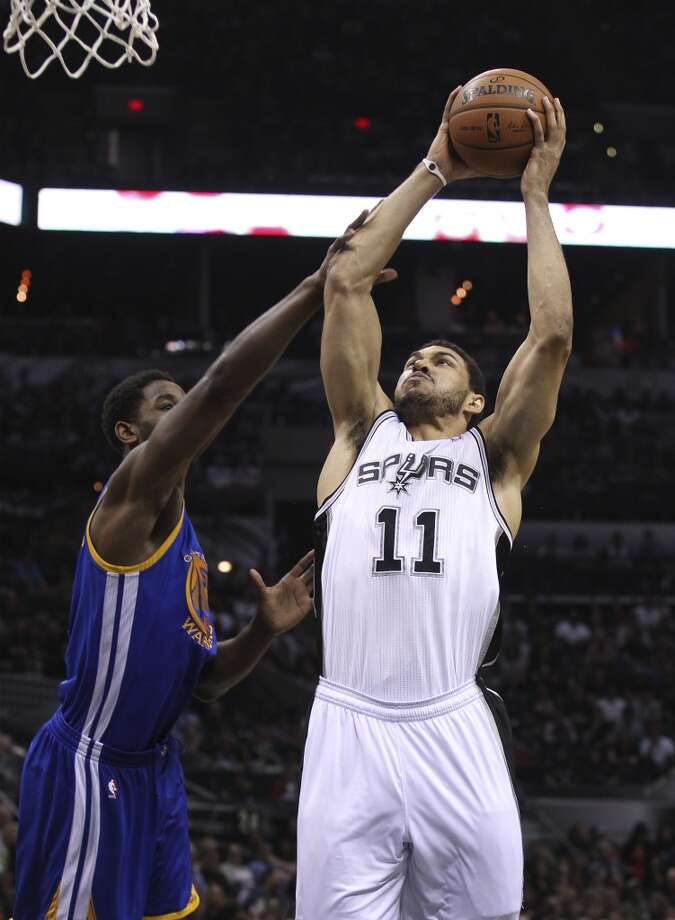 Spurs' Jeff Ayres (11) goes up for a dunk against Golden State Warriors' Hilton Armstrong (57) in the second half at the AT&T Center on Wednesday, April 2, 2014. Spurs defeated the Warriors, 111-90. Photo: Kin Man Hui, San Antonio Express-News