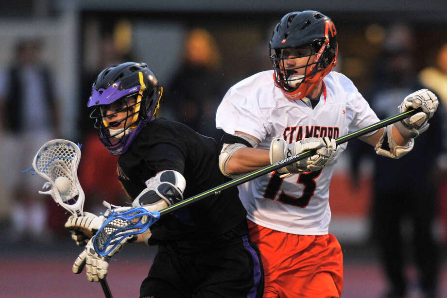 Westhill's Shawn DiPietro meets resistance from Stamford's Matthew McGoldrick during their game at Stamford High School in Stamford, Conn., on Thursday, May 22, 2014. Stamford won, 8-2. Photo: Jason Rearick / Stamford Advocate