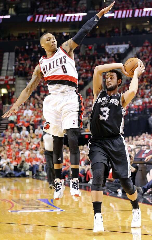San Antonio Spurs' Marco Belinelli looks to pass around Portland Trail Blazers' Damian Lillard during first half action of Game 3 in the Western Conference semifinals Saturday May 10, 2014 at the Moda Center in Portland, OR. Photo: Edward A. Ornelas, San Antonio Express-News