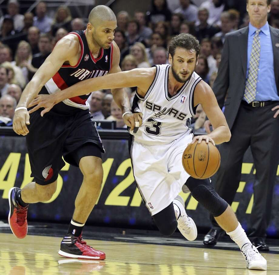 San Antonio Spurs' Marco Belinelli looks for room around Portland Trail Blazers' Nicolas Batum during second half action of Game 2 in the Western Conference semifinals Thursday May 8, 2014 at the AT&T Center. The Spurs won 114-97. Photo: Edward A. Ornelas, San Antonio Express-News