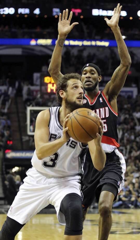 San Antonio Spurs' Marco Belinelli looks for room around Portland Trail Blazers' Will Barton during second half action of Game 1 in the Western Conference semifinals Tuesday May 6, 2014 at the AT&T Center. The Spurs won 116-92. Photo: Edward A. Ornelas, San Antonio Express-News