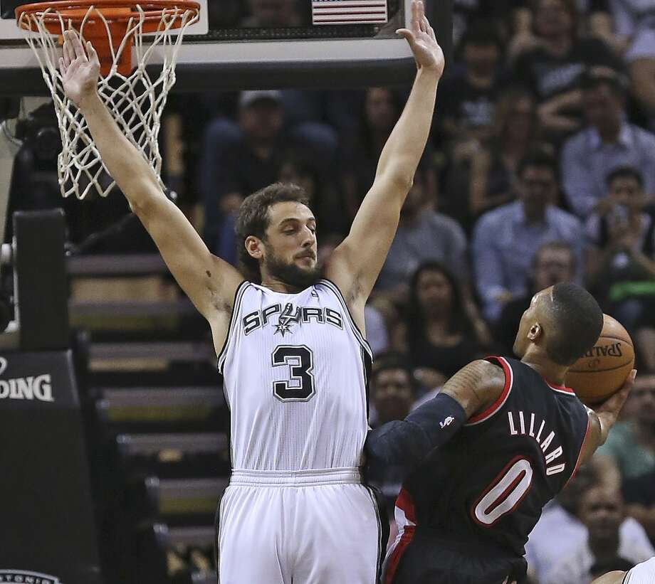 Marco Belinelli goes up to defend against a charging Damian Lillard as the San Antonio Spurs play the Portland Trailblazers in game 2 of the Western Conference Semifinals at the AT&T Center on May 8, 2014. Photo: TOM REEL