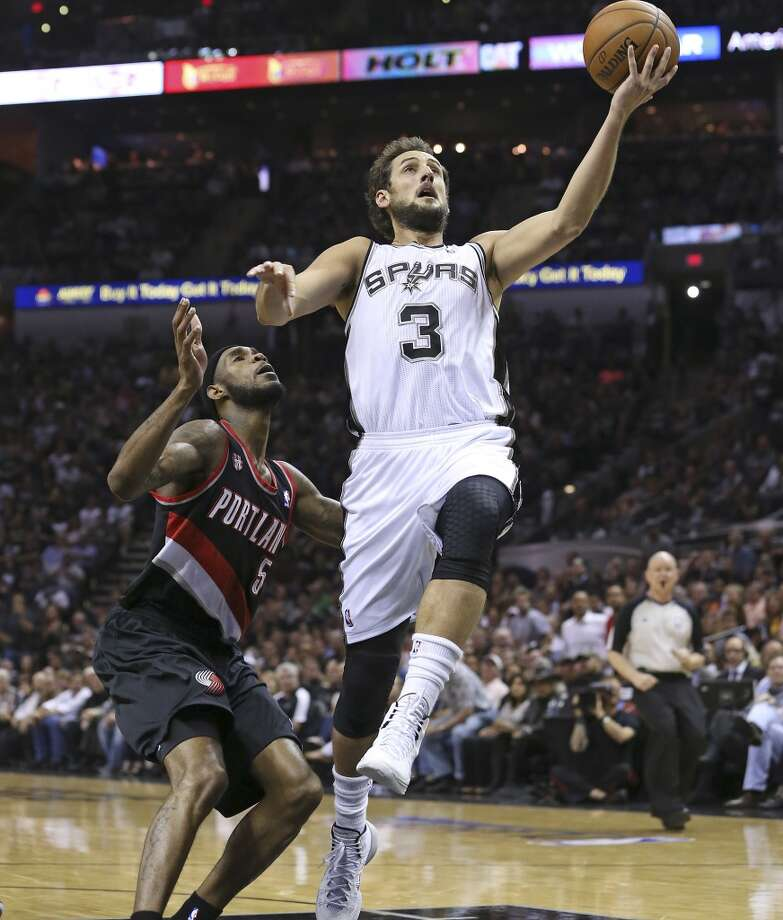 Marco Belinelli wins a fast break race to the hoop against  Will Barton as the San Antonio Spurs play the Portland Trailblazers in game 2 of the Western Conference Semifinals at the AT&T Center on May 8, 2014. Photo: TOM REEL, San Antonio Express-News