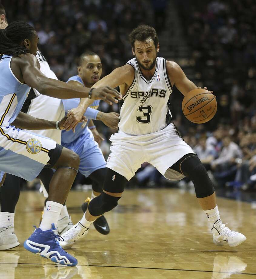 San Antonio Spurs' Marco Belinelli drives the ball during the first half against the Denver Nuggets at the AT&T Center, Wednesday, March 26, 2014. Photo: Jerry Lara, San Antonio Express-News