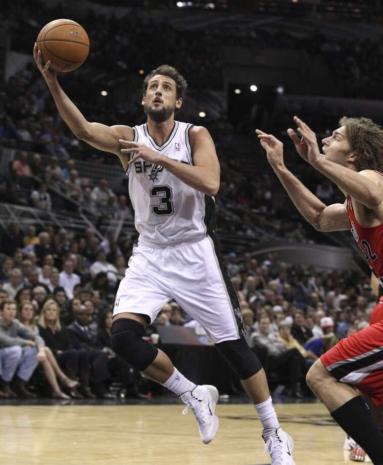 Spurs' Marco Belinelli (03) attempts a shot against Portland Trailblazers' Robin Lopez (42) in the second half at the AT&T Center on Wednesday, Mar. 12, 2014. Spurs defeated the Trailblazers, 103-90. (Kin Man Hui/San Antonio Express-News) Photo: Kin Man Hui, San Antonio Express-News