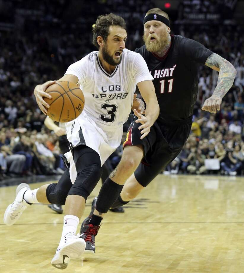 San Antonio Spurs' Marco Belinelli drives around Miami Heat's Chris Andersen during second half action Thursday March 6, 2014 at the AT&T Center. The Spurs won 111-87. Photo: Edward A. Ornelas, San Antonio Express-News