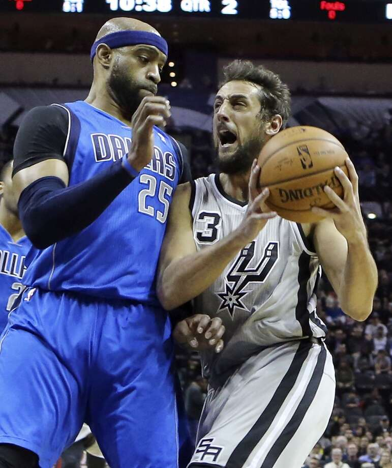 San Antonio Spurs' Marco Belinelli reacts after being fouled by Dallas Mavericks' Vince Carter during first half action Sunday March 2, 2014 at the AT&T Center. Photo: Edward A. Ornelas, San Antonio Express-News