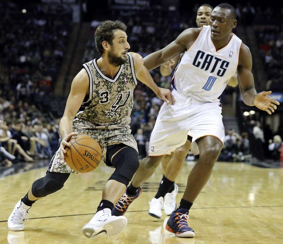 San Antonio Spurs' Marco Belinelli looks for room around Charlotte Bobcats' Bismack Biyombo during second half action Friday Feb. 28, 2014 at the AT&T Center. The Spurs won 92-82. Photo: Edward A. Ornelas, San Antonio Express-News