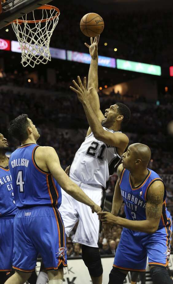 Tim Duncan gets inside for a tough shot as the San Antonio Spurs play the Oklahoma City Thunder in game 2 of the Western Conference Finals at the AT&T Center on May 21, 2014. Photo: Tom Reel, San Antonio Express-News
