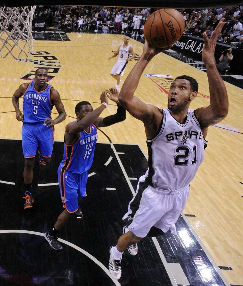 San Antonio Spurs' Tim Duncan shoots around Oklahoma City Thunder's Reggie Jackson during second half action of Game 2 in the Western Conference Finals Wednesday May 21, 2014 at the AT&T Center. The Spurs won 112-77. Photo: Edward A. Ornelas, San Antonio Express-News