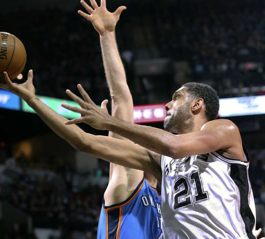 Tim Duncan uses a scoop shot for two points as the Spurs play the Thunder in the opener of the NBA Western Conference finals at the AT&T Center on May 19, 2014. Photo: Tom Reel, San Antonio Express-News