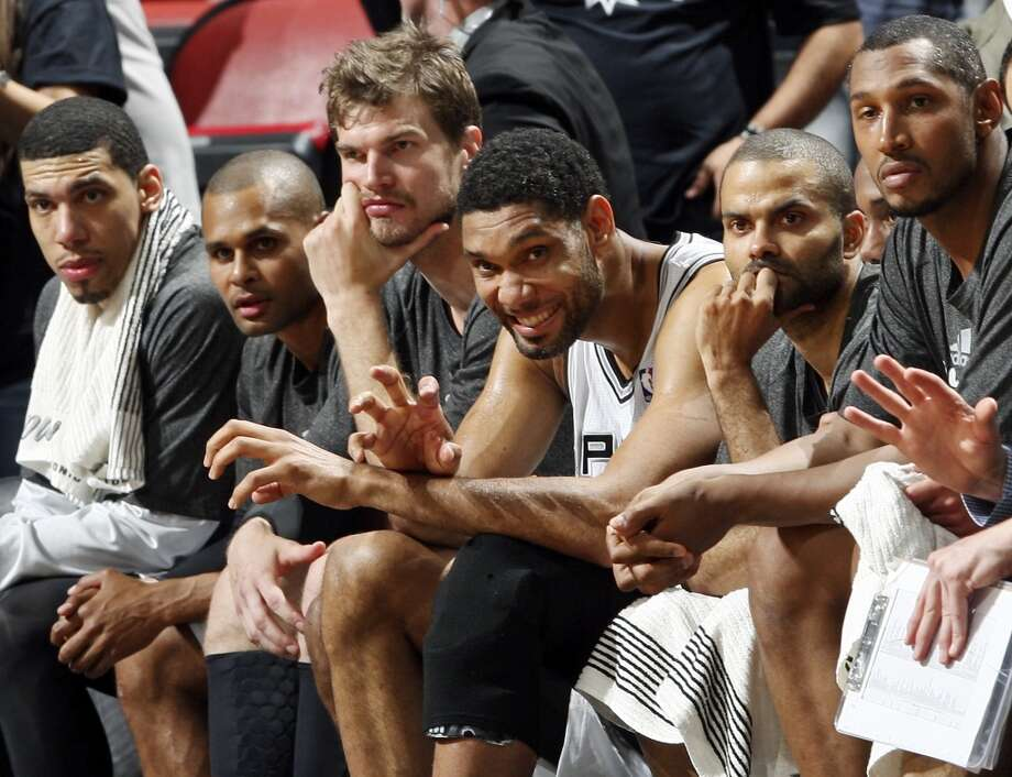 San Antonio Spurs' Danny Green (from left), Patty Mills, Tiago Splitter, Tim Duncan, Tony Parker, and Boris Diaw  watch late action of Game 1 in the Western Conference Finals against the Oklahoma City Thunder from the bench Monday May 19, 2014 at the AT&T Center. The Spurs won 122-105. Photo: Edward A. Ornelas, San Antonio Express-News
