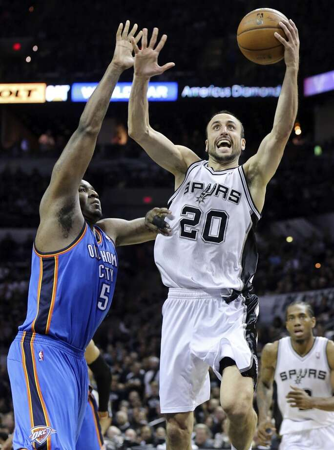 San Antonio Spurs' Manu Ginobili drives to the basket around Oklahoma City Thunder's Kendrick Perkins during second half action of Game 1 in the Western Conference Finals Monday May 19, 2014 at the AT&T Center. The Spurs won 122-105. Photo: Edward A. Ornelas, San Antonio Express-News