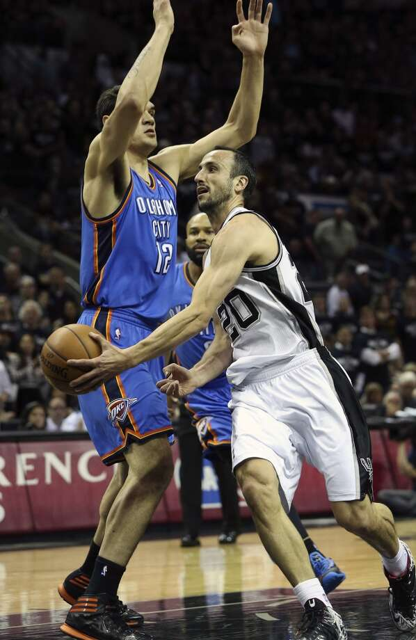 Manu Ginobili makes a pass around Steven Adams in first half as the Spurs play the Thunder in the opener of the NBA Western Conference finals at the AT&T Center on May 19, 2014. Photo: Tom Reel, San Antonio Express-News