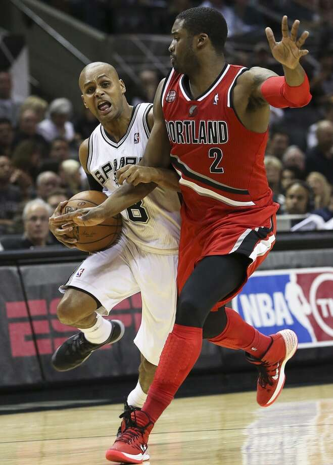 Patty Mills battles Wesley Matthews to the hoop and scores as the Spurs play Portland in game 5 of the NBA Western Conference semifinals at the AT&T Center  on May 14, 2014. Photo: Tom Reel, San Antonio Express-News