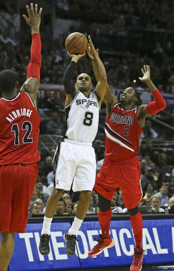 Patty Mills splits the defense of LaMarcus Aldridge and Wesley Matthews to get a shot as the Spurs play Portland in game 5 of the NBA Western Conference semifinals at the AT&T Center  on May 14, 2014. Photo: TOM REEL, San Antonio Express-News