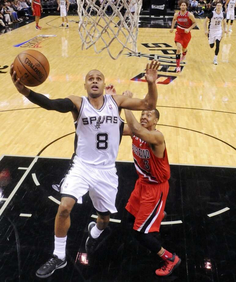 San Antonio Spurs' Patty Mills shoots around Portland Trail Blazers' C.J. McCollum during first half action of Game 5 in the Western Conference semifinals Wednesday May 14, 2014 at the AT&T Center. Photo: Edward A. Ornelas, San Antonio Express-News