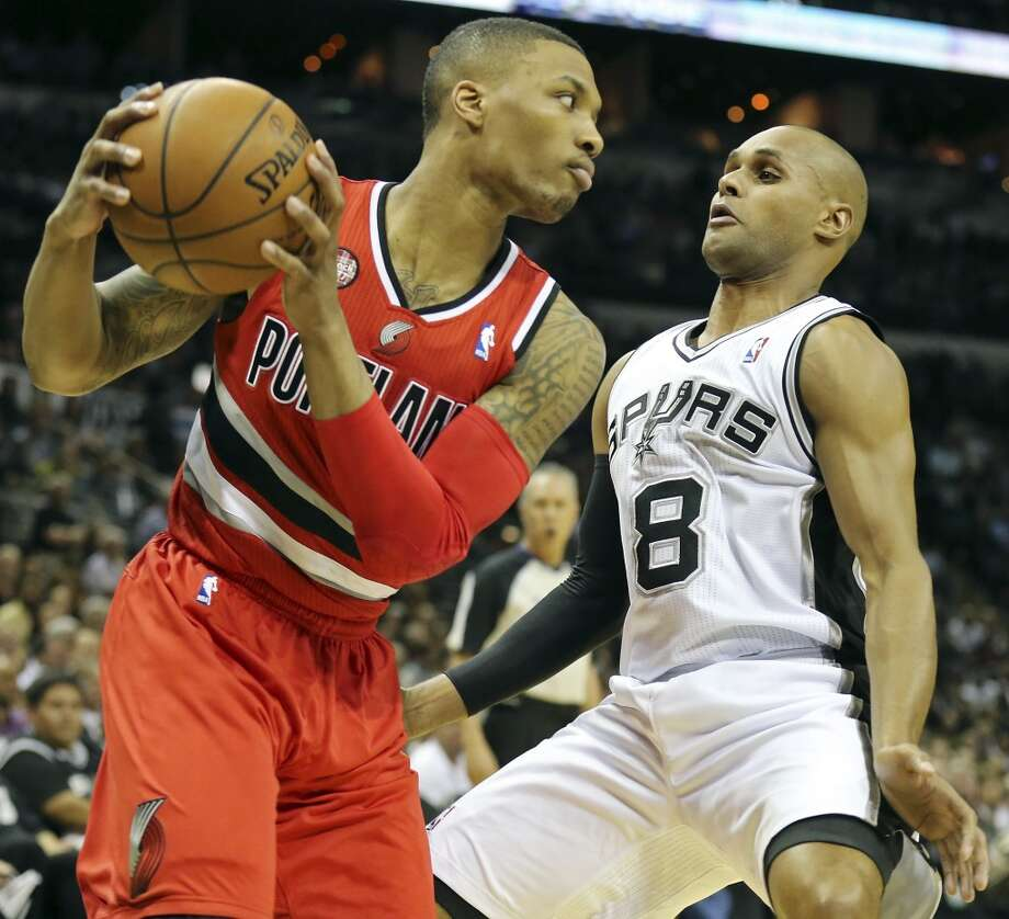 Portland Trail Blazers' Damian Lillard looks for room around San Antonio Spurs' Patty Mills during first half action of Game 5 in the Western Conference semifinals Wednesday May 14, 2014 at the AT&T Center. Photo: Edward A. Ornelas, San Antonio Express-News