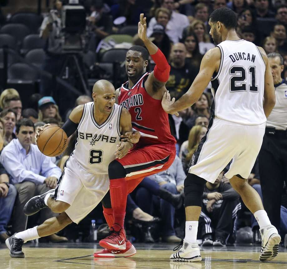 San Antonio Spurs' Patty Mills looks for room around Portland Trail Blazers' Wesley Matthews as San Antonio Spurs' Tim Duncan moves in on the play during second half action of Game 5 in the Western Conference semifinals Wednesday May 14, 2014 at the AT&T Center. The Spurs won 104-82. Photo: Edward A. Ornelas, San Antonio Express-News
