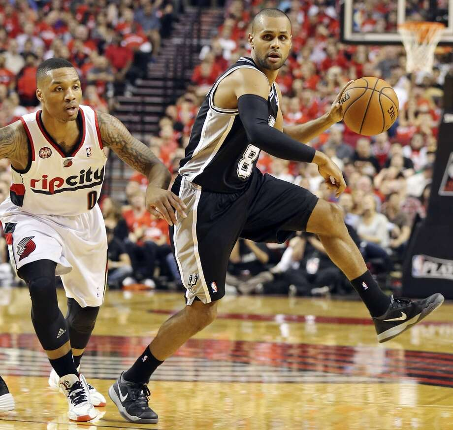 San Antonio Spurs' Patty Mills looks for room around Portland Trail Blazers' Damian Lillard during first half action of Game 4 in the Western Conference semifinals Monday May 12, 2014 at the Moda Center in Portland, OR. Photo: Edward A. Ornelas, San Antonio Express-News